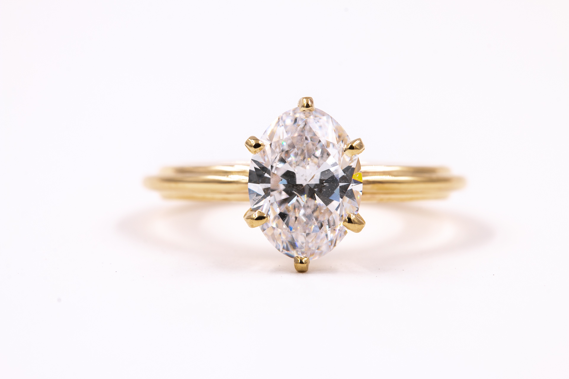 oval-solitaire-engagement-ring-gold-