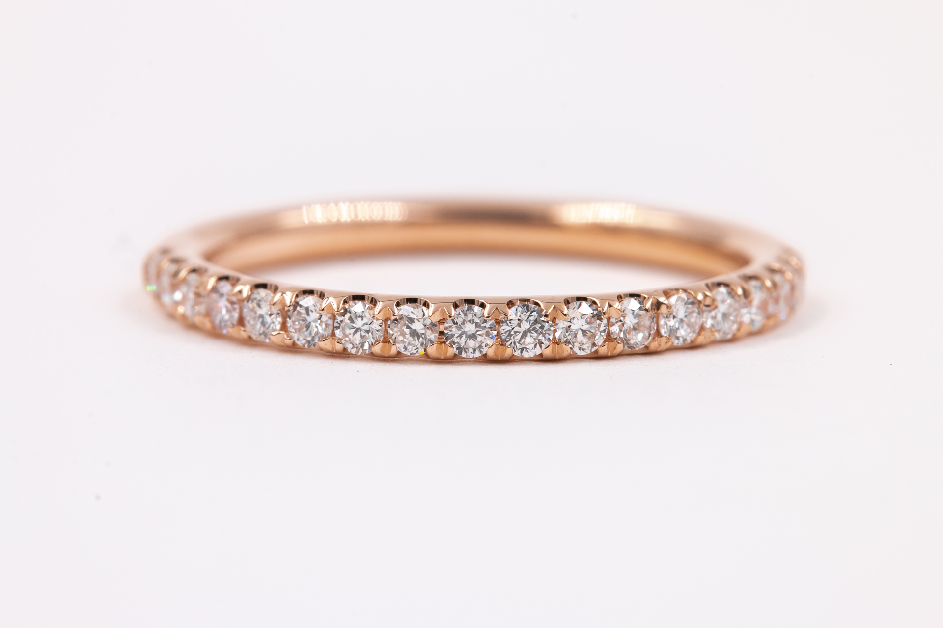 rose-gold-eternity-band-jewelry-store