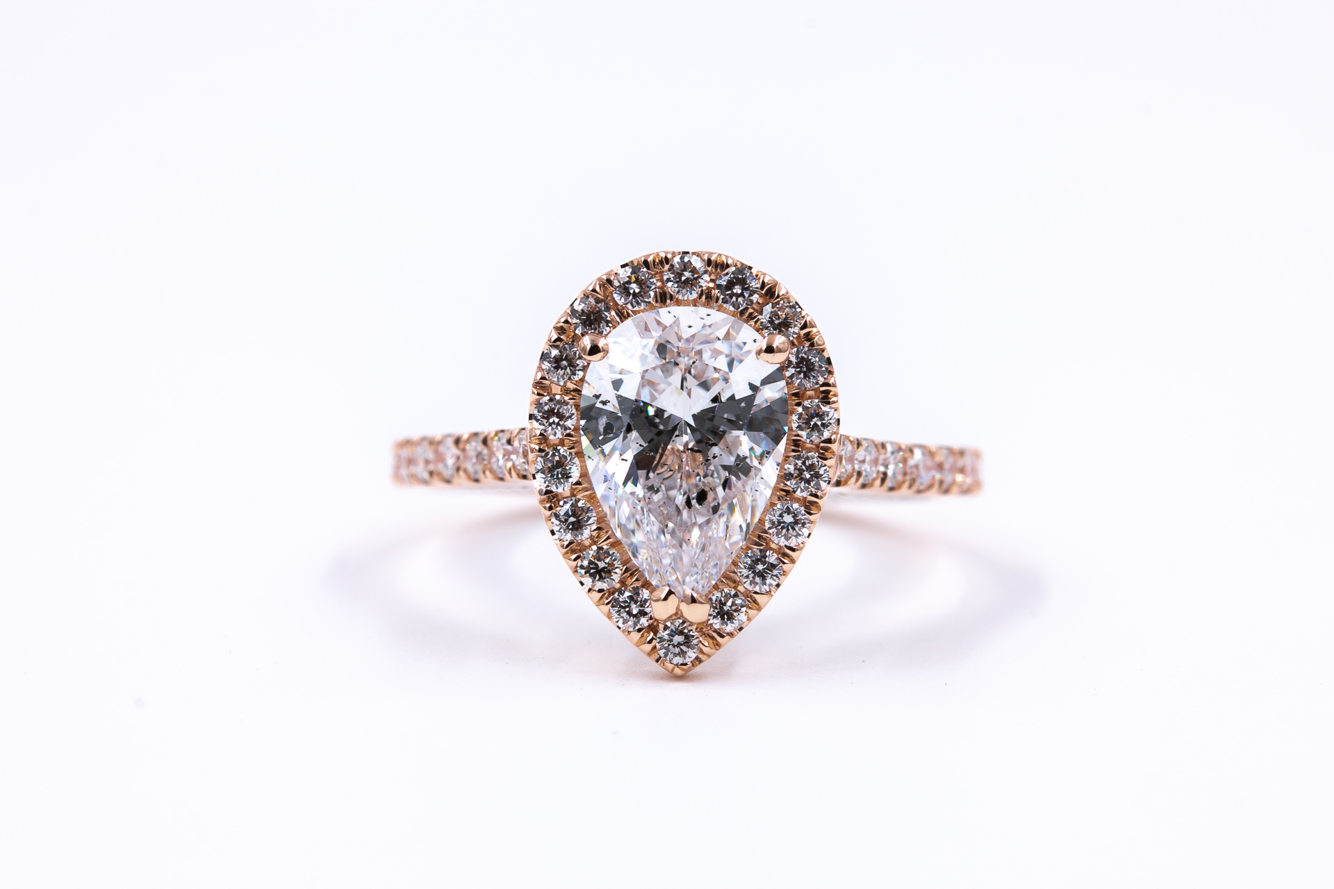 rose-gold-pear-halo-engagement-ring-